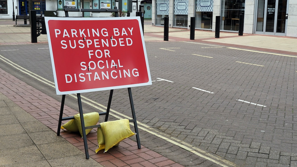 Sign showing social distancing in city