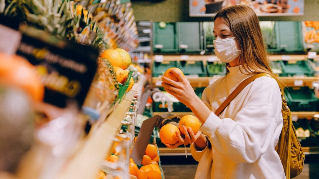 Woman wearing mask whilst grocery shopping